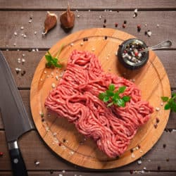 Minced meat on rustic wooden background