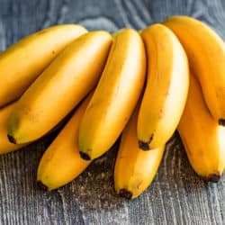 Bunch of bananas on wooden background